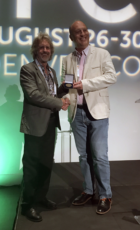 Lionel Larue awarded the ESPCR H.S. Raper Medal by Past President Ian Jackson at the IPCC2017 Conference in Denver, Colorado, USA.